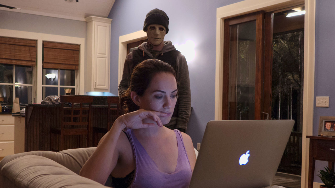 Hush, a horror movie where a masked intruder taunts a deaf woman.